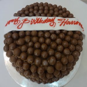 Chocolate cake fully coverd with chocolate ballse - Flowers, Cakes and Gifts delivery in Dubai UAE