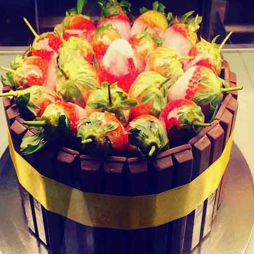 Kit Kat cake with fresh strawberry filled as topping - Flowers, Cakes and Gifts delivery in Dubai UAE
