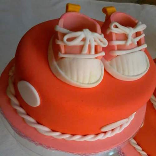 Orange Icing Cake with Baby Shoes - Flowers, Cakes and Gifts delivery in Dubai UAE