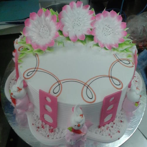 Pink flowers on white creamy cake - SKUCAK036 - Flowers, Cakes and Gifts delivery in Dubai UAE